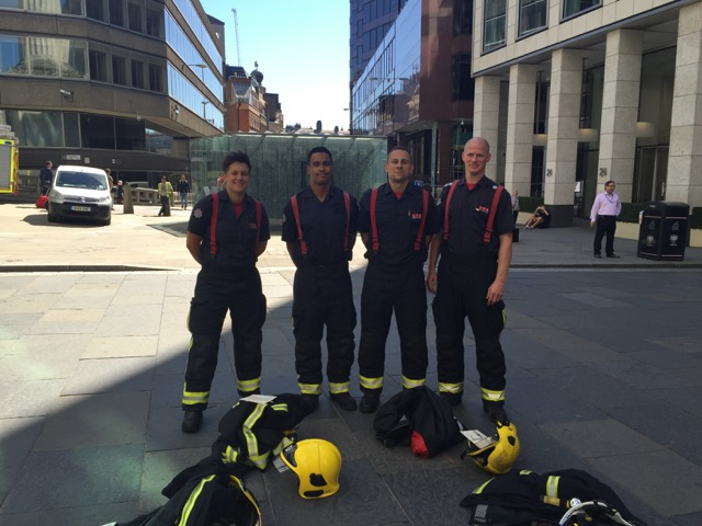 Smiles all round - Firefighters about to climb up The Monument in full uniform...